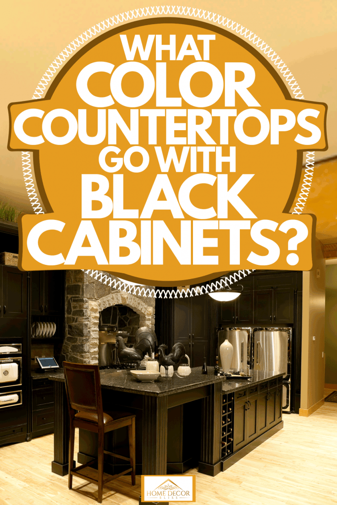 A classic themed kitchen area with black paneled cabinets and a marble countertop, What Color Countertops Go With Black Cabinets?