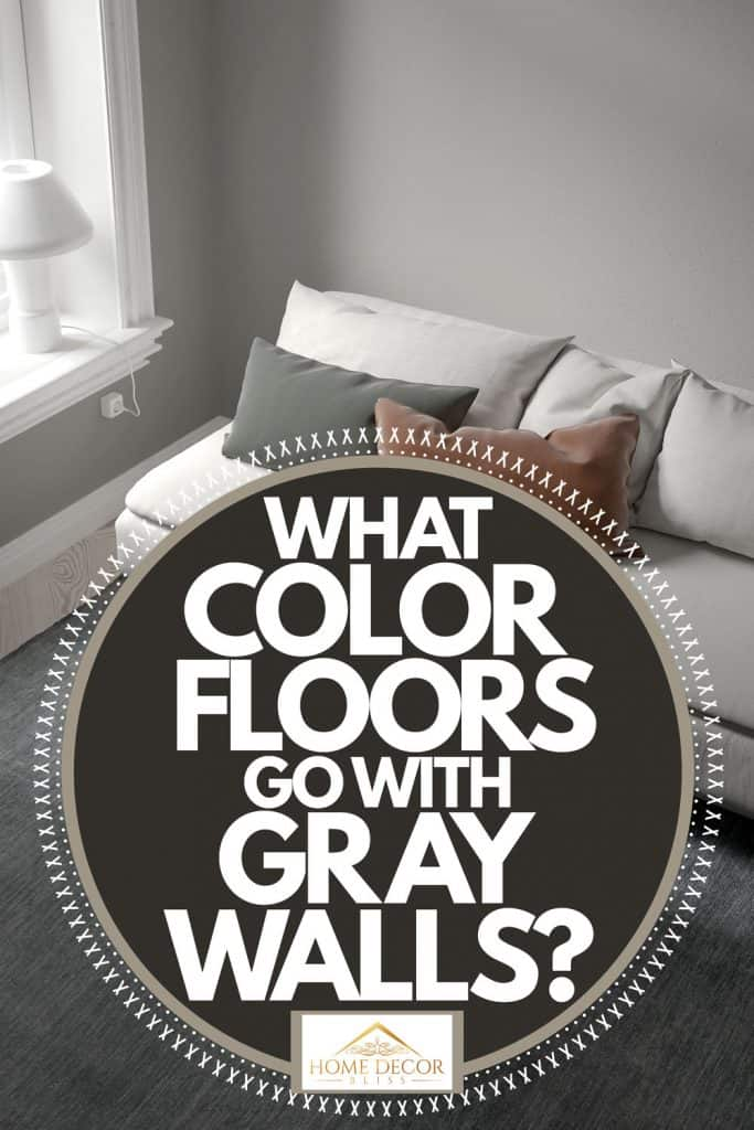 Living room with gray walls, gray couch, and a rug with black rug on top of a patterned flooring, What Color Floors Go With Gray Walls?