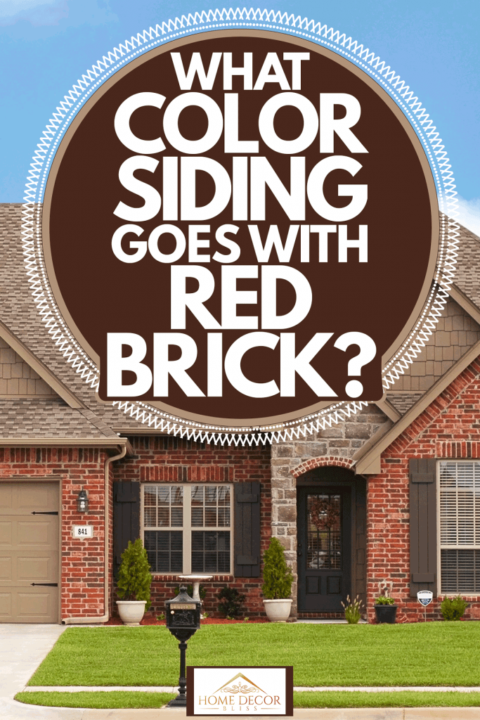 Brick house with a country inspired design matched with shingle roofing and French windows, What Color Siding Goes With Red Brick?