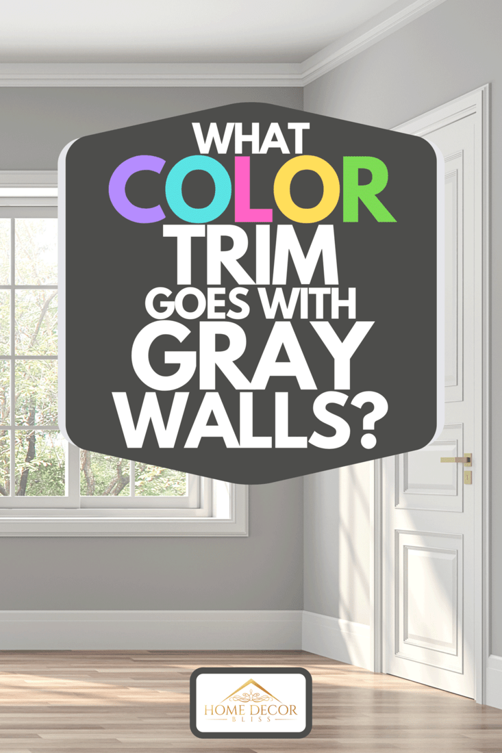 A classical empty room interior with wooden floors, gray walls and decorated with white moulding, What Color Trim Goes With Gray Walls?