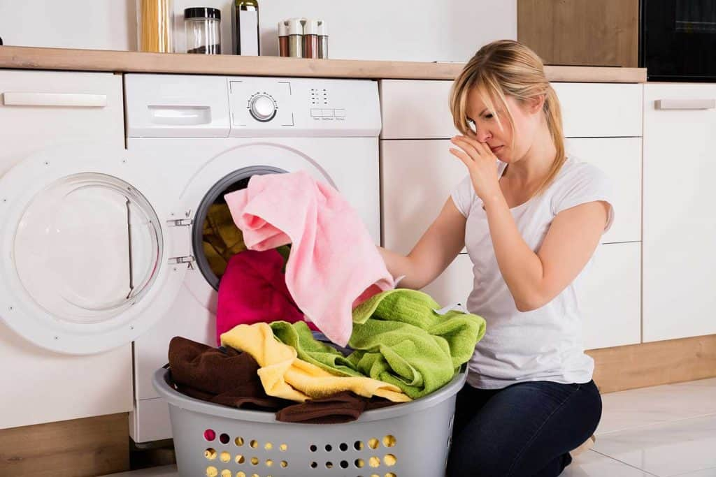 Woman unloading clothes doing laundry