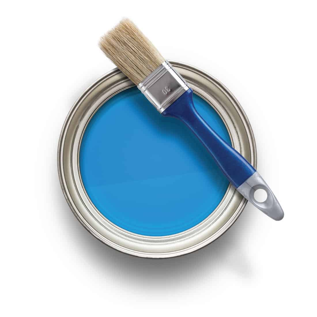 A can of blue paint with brush on the rim
