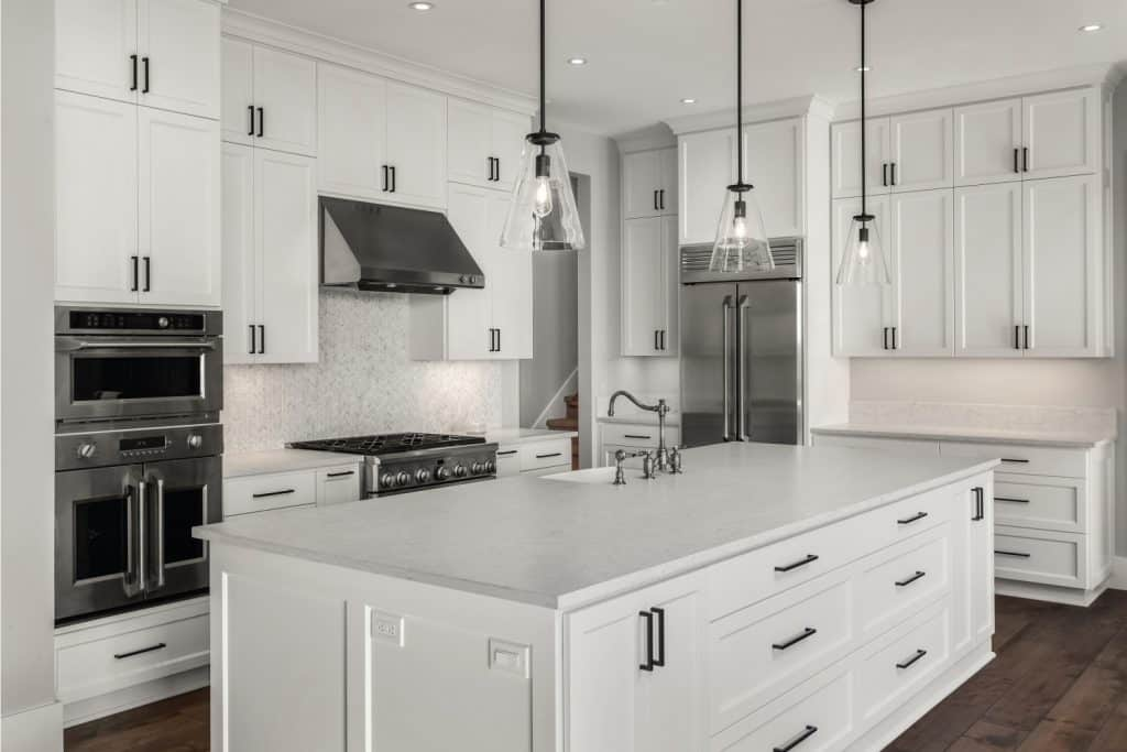All white with black accent kitchen in newly constructed luxury home