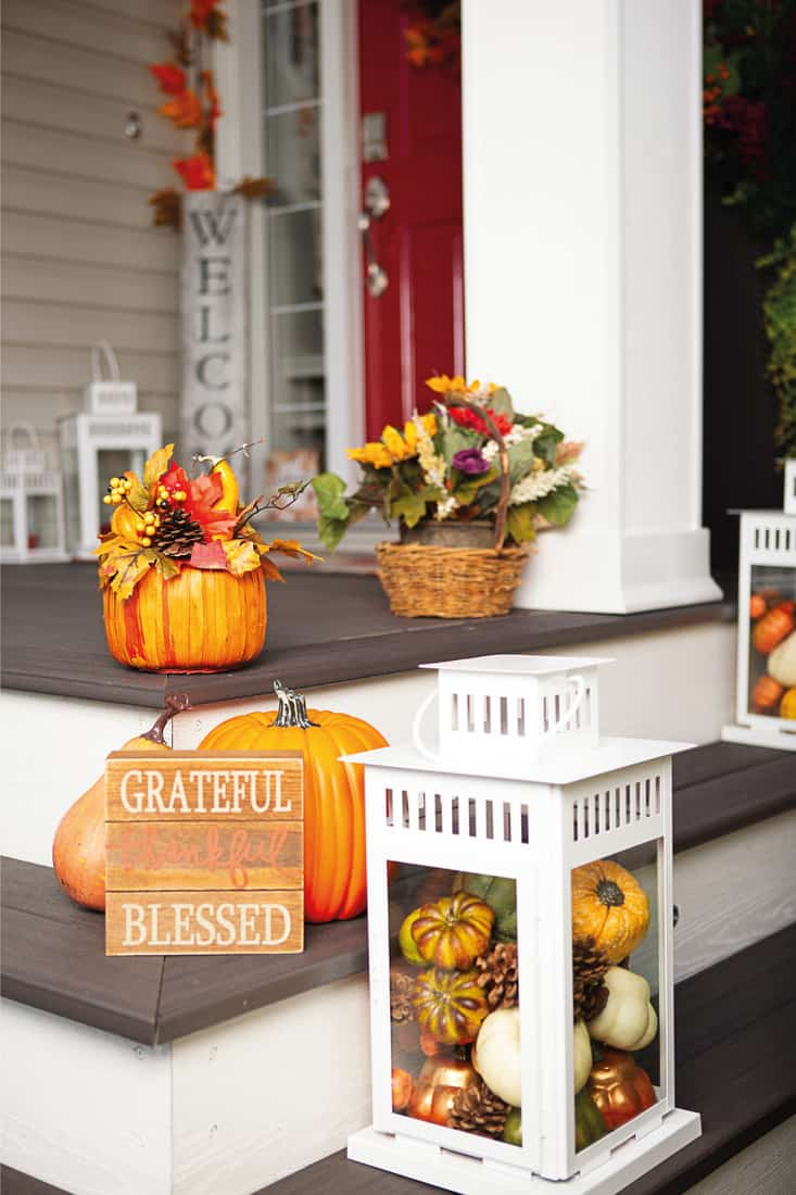 Beautiful front porch with fall decor and welcome sign