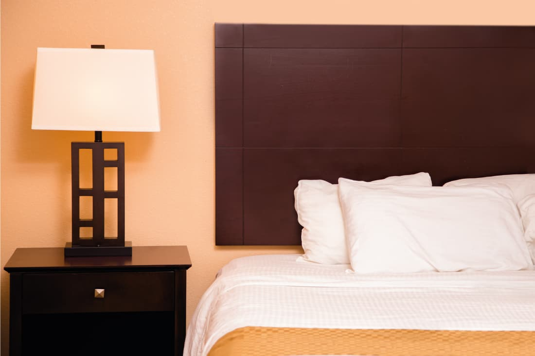 dark cherry wood furniture with a gold color scheme throughout the room