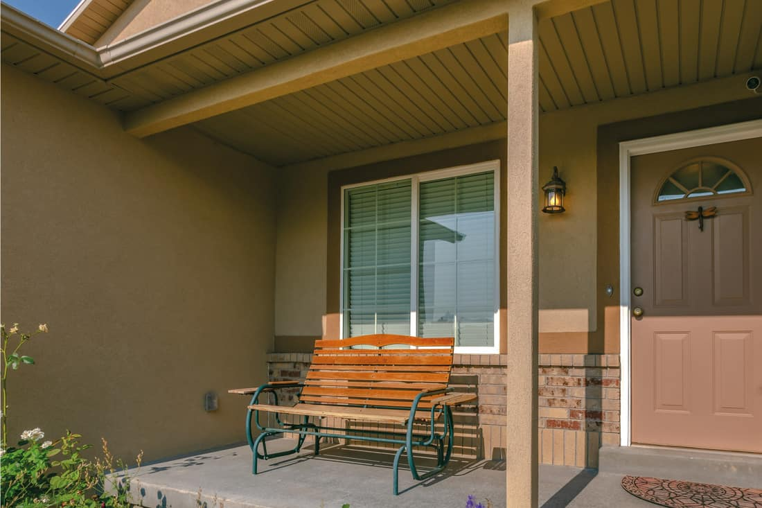 Front porch with tchotchkes hung on the wooden door