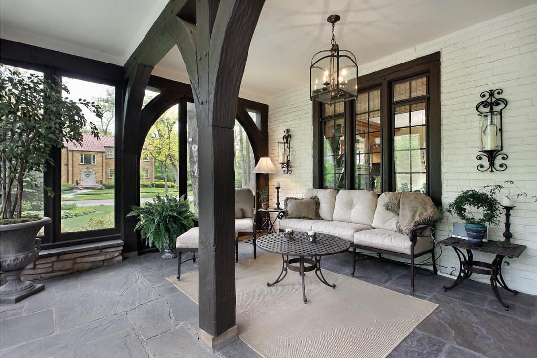 Front porch with wooden beams and candlelight decor