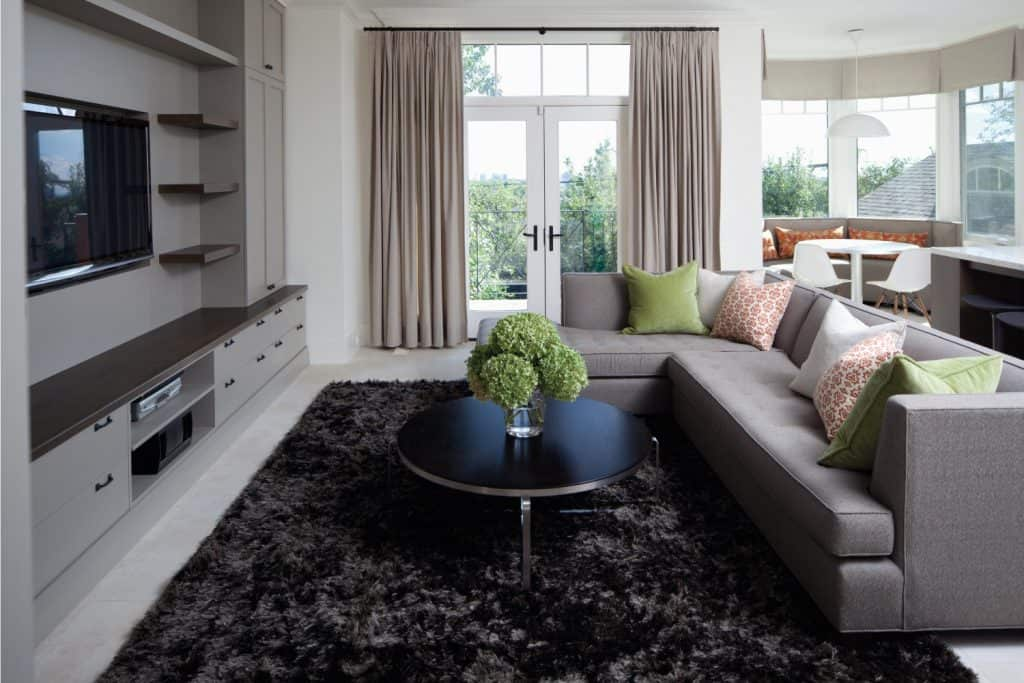 Great living room in gray concept with large sectional couch as the centerpiece