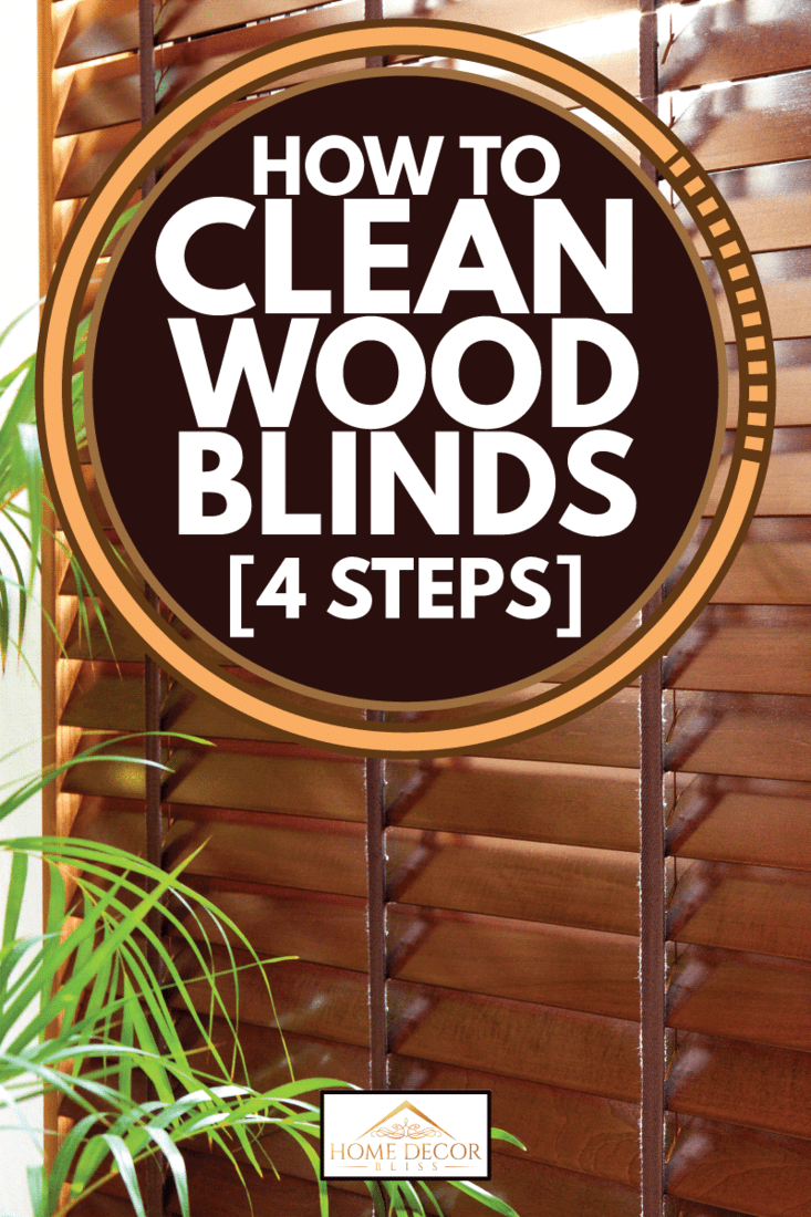 hard wood blind attached on a window frame with indoor plants in front, How to Clean Wood Blinds [4 Steps]