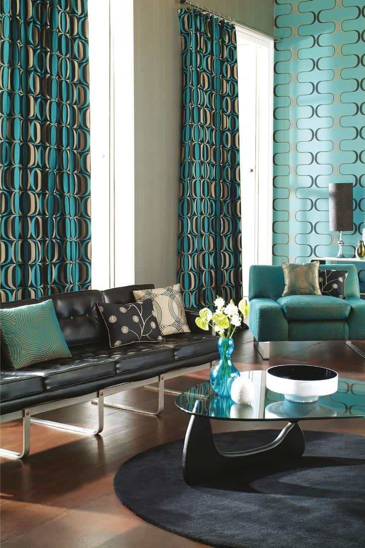 interior of colourful contemporary living room with sofa, with curtains, table and vases