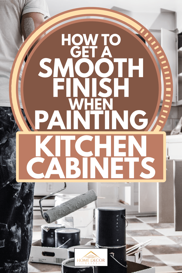 Man holding a paint roller looking at kitchen cabinet paint job, How To Get A Smooth Finish When Painting Kitchen Cabinets