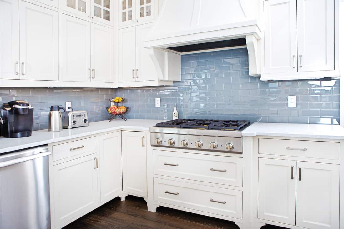 modern kitchen with white cabinets and countertops