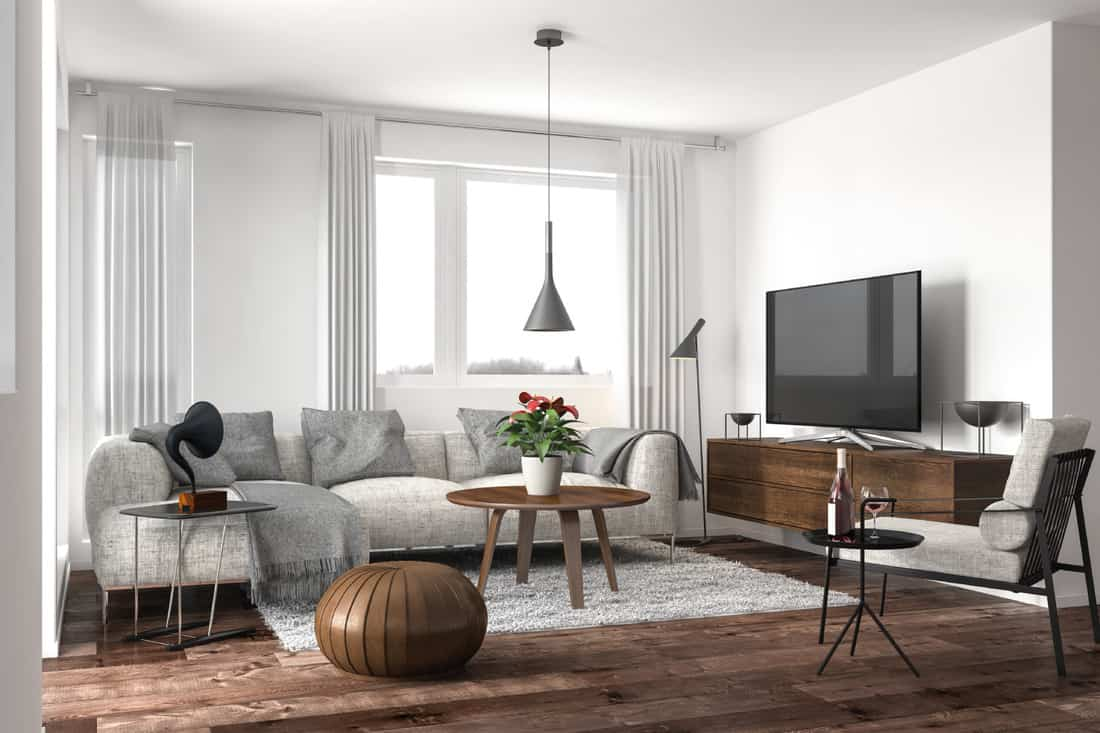 Modern living room with gray sectional sofa and dark wooden furniture