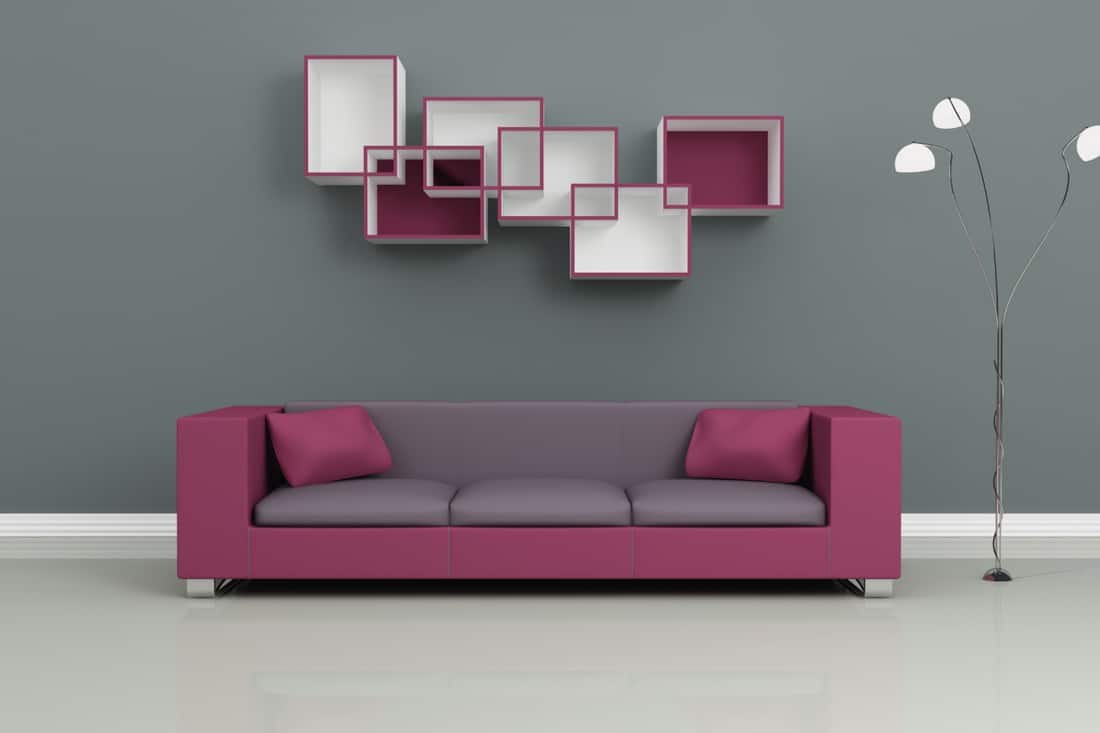 purple sofa against a gray wall with purple decorations