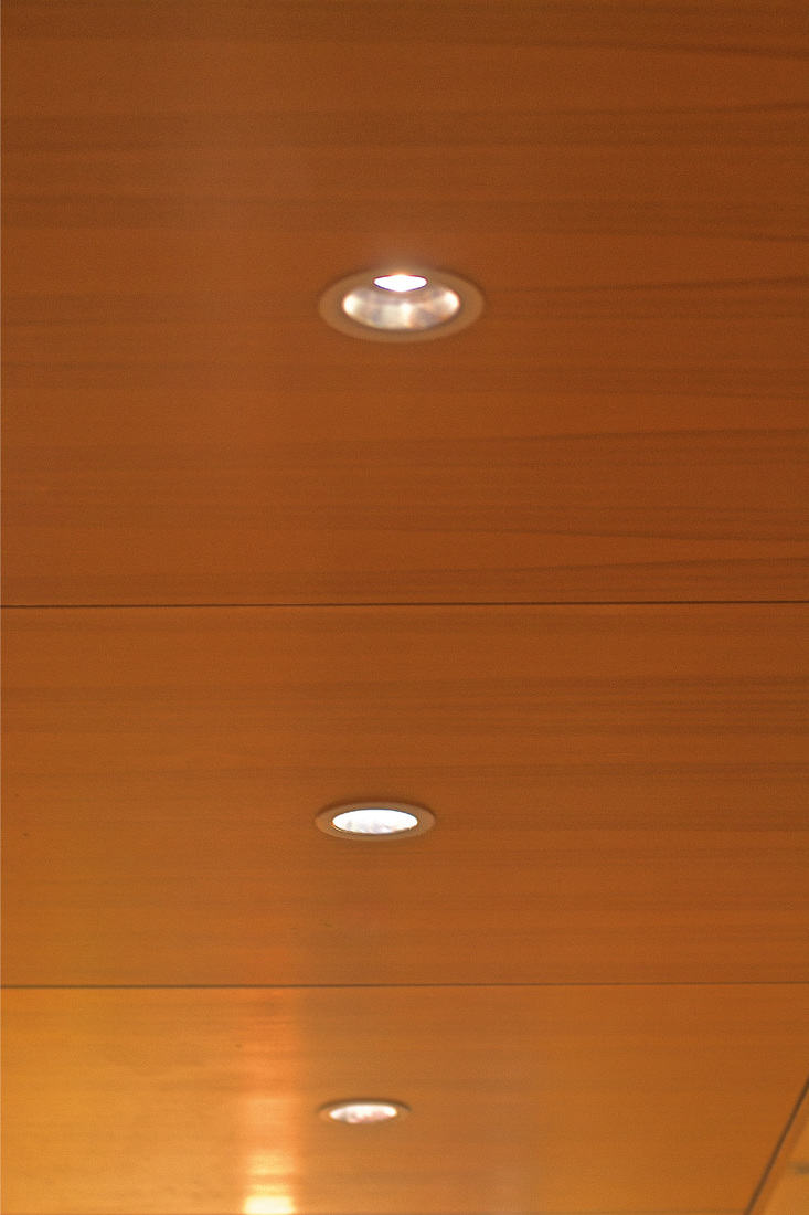 recessed lighting on a wooden ceiling