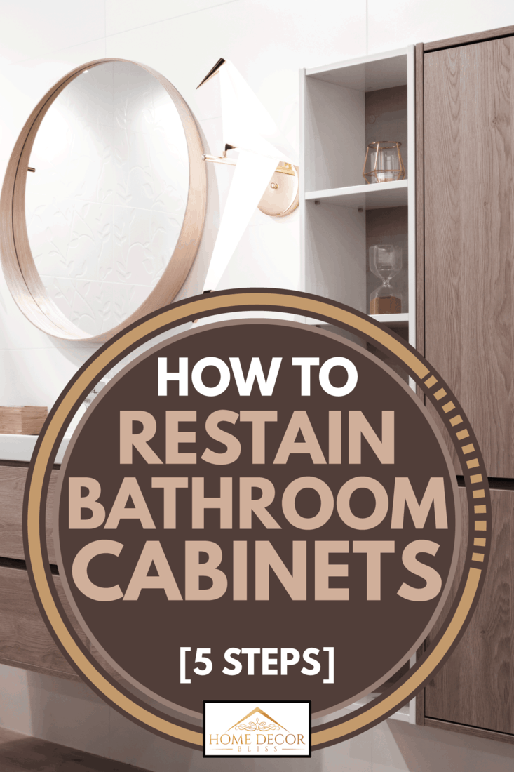 stained wood cabinet in a bathroom with sink faucet and vanity mirror, How to restain bathroom cabinets [5 steps]