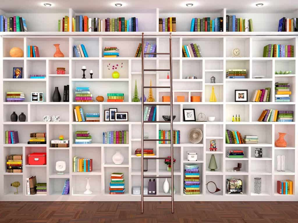 White bookshelves in the interior with various objects