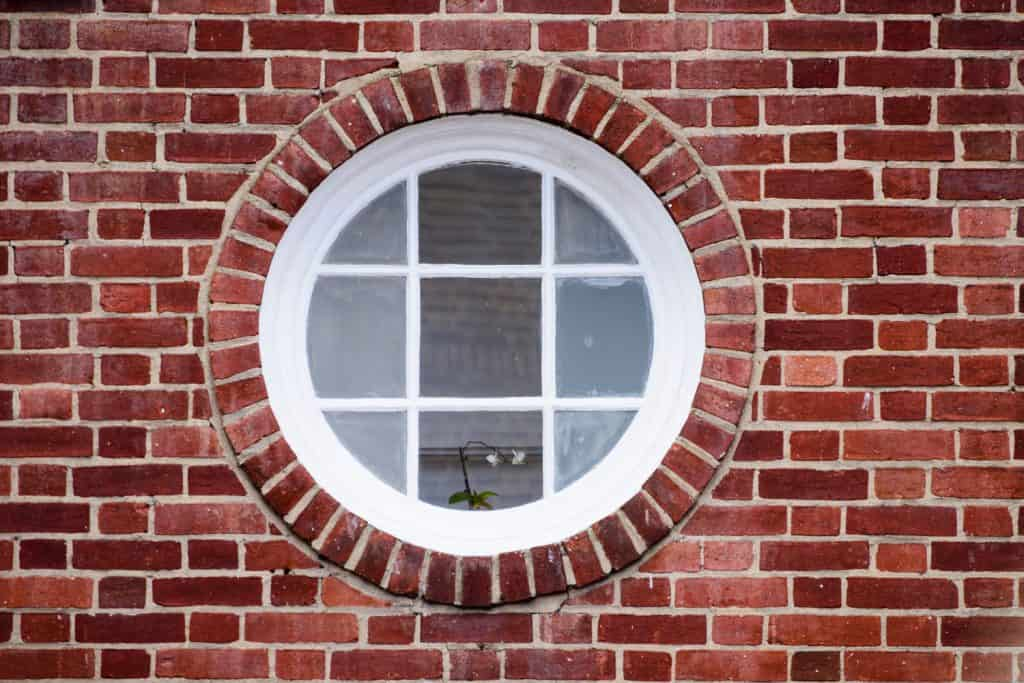 A Victorian inspired round window made from bricks