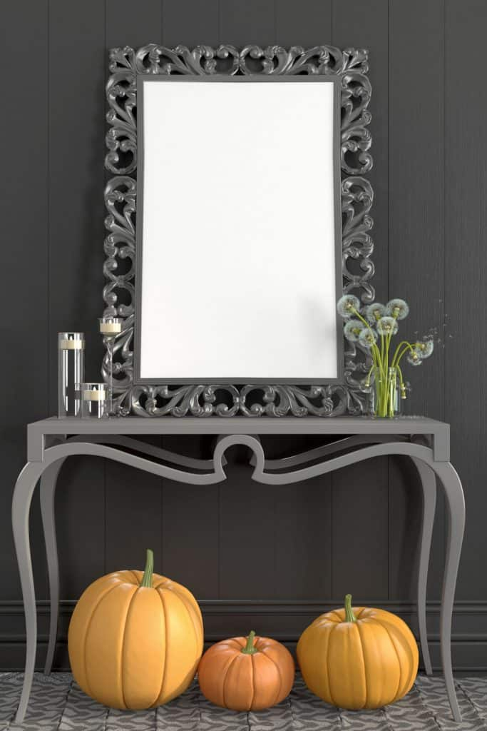 A vintage type console table with a mirror on the top