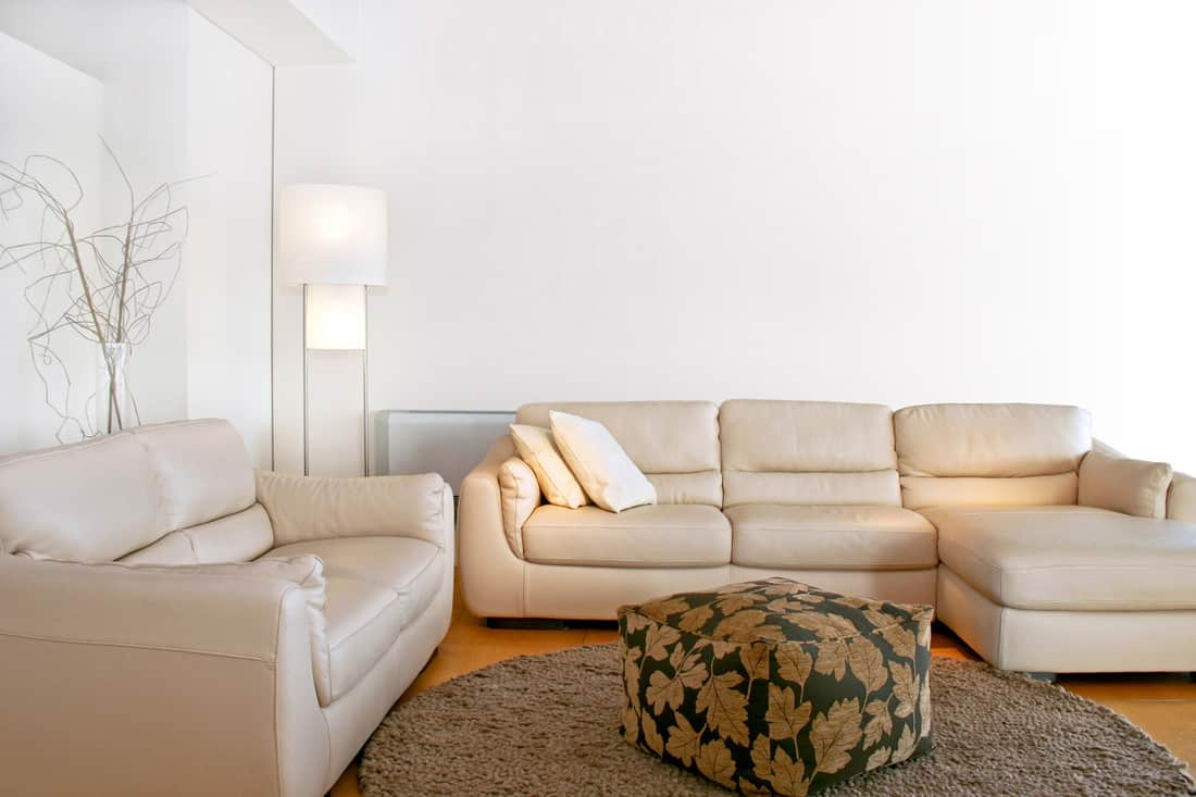 A bright luxurious living room with no end tables