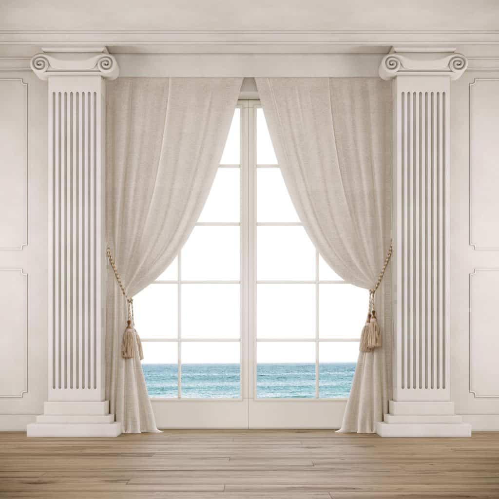 A classic designed window with a Olympian styled column with a white curtain