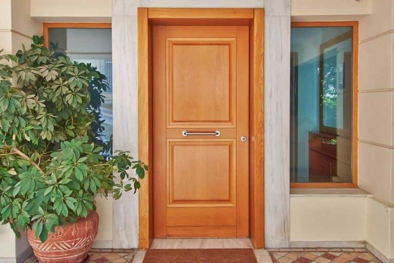 A contemporary wooden house door, 10 Types Of Door Sweeps And Bottom Seals