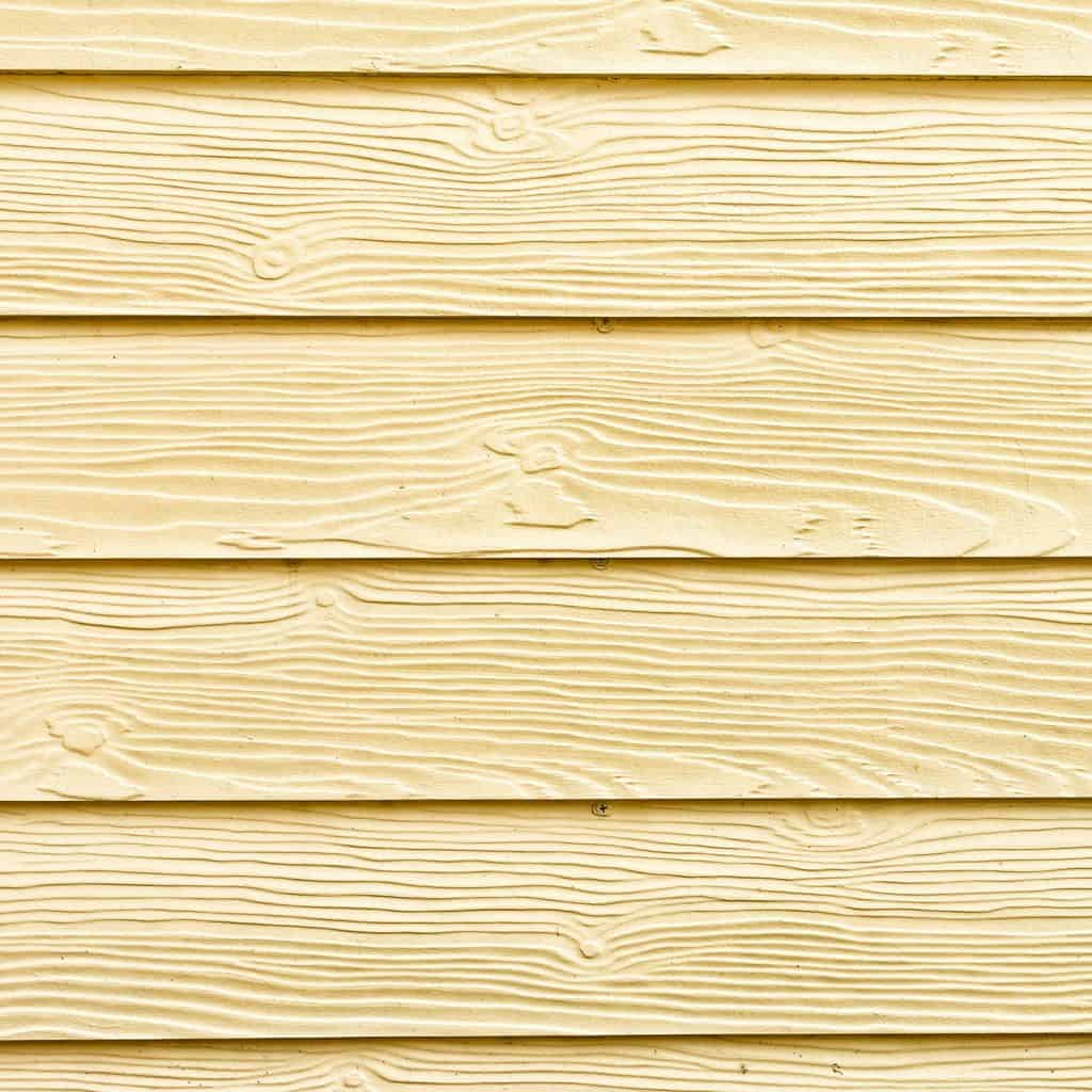 A detailed view of wooden painted vinyl siding