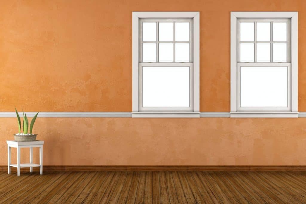 A double hung window inside an orange window