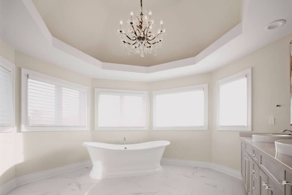 A gorgeous white walled bathroom with a bay window