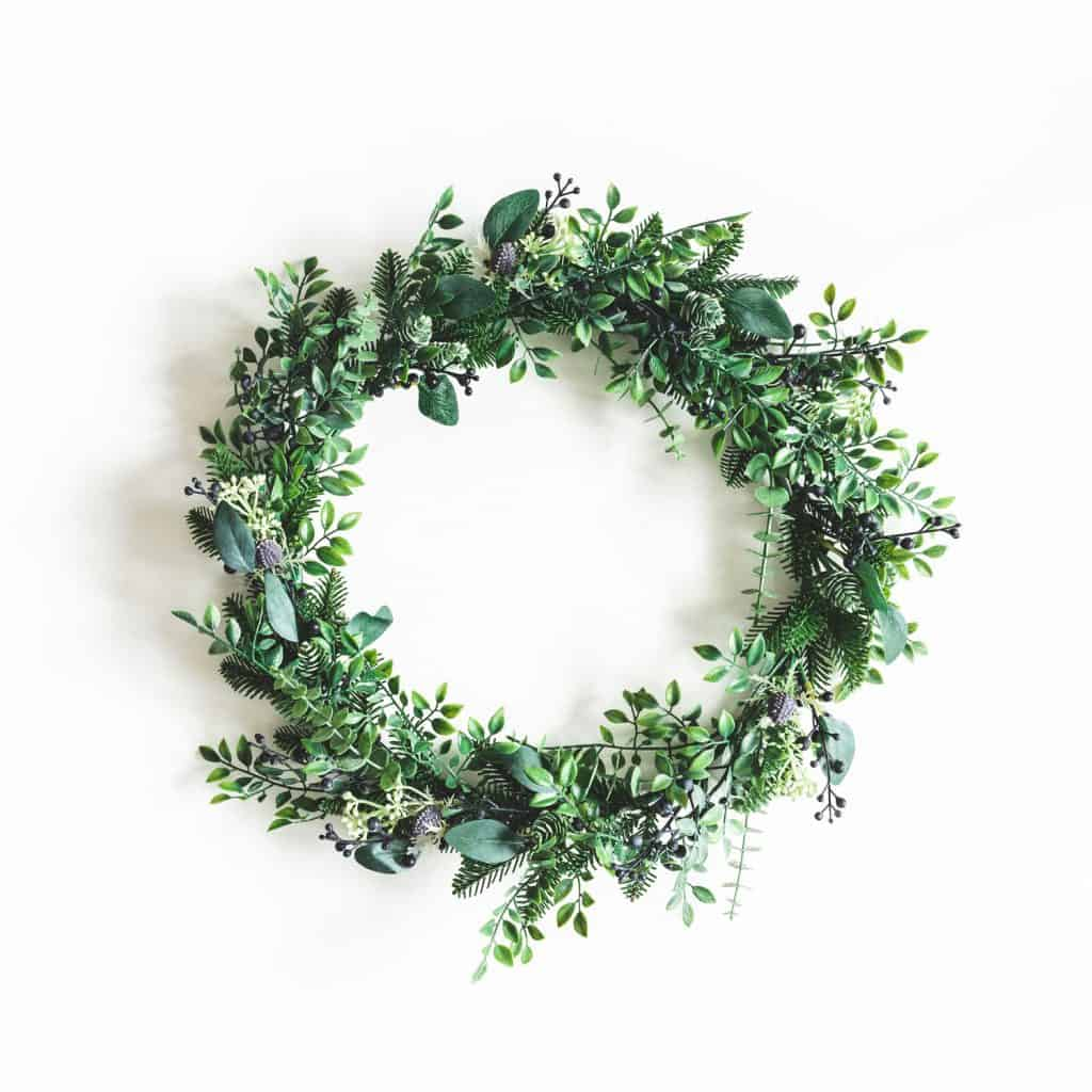 A gorgeous wreath made with leaves isolated on a white background