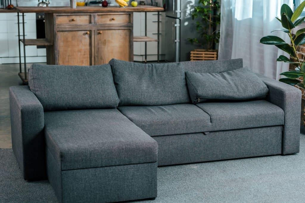 A gray sectional sofa inside a contemporary living room