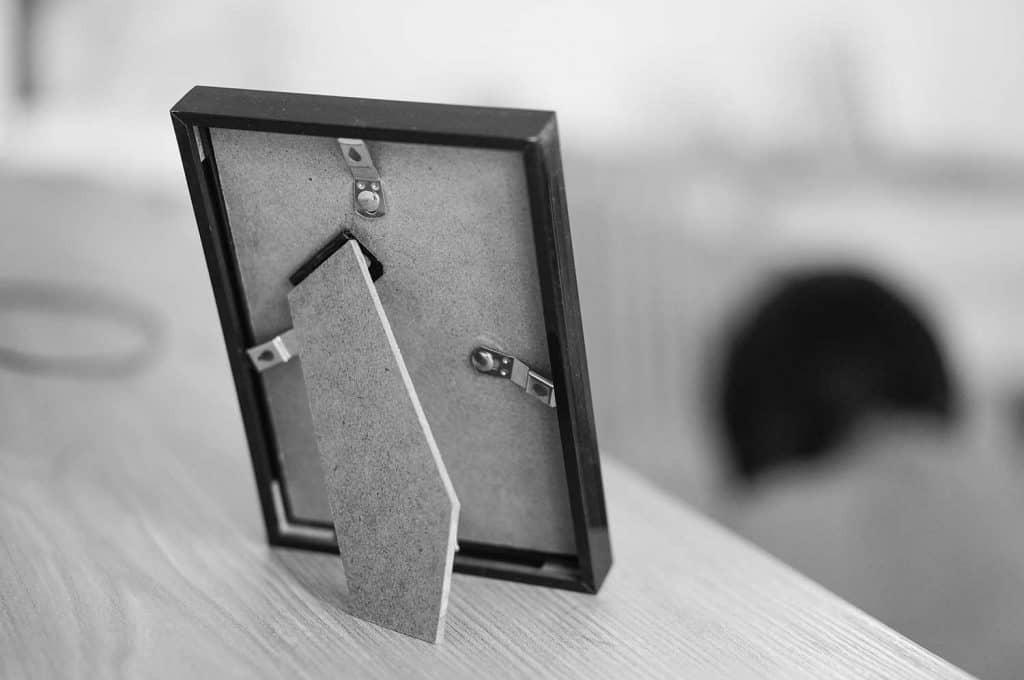 A grayscale shot of a photo frame backside