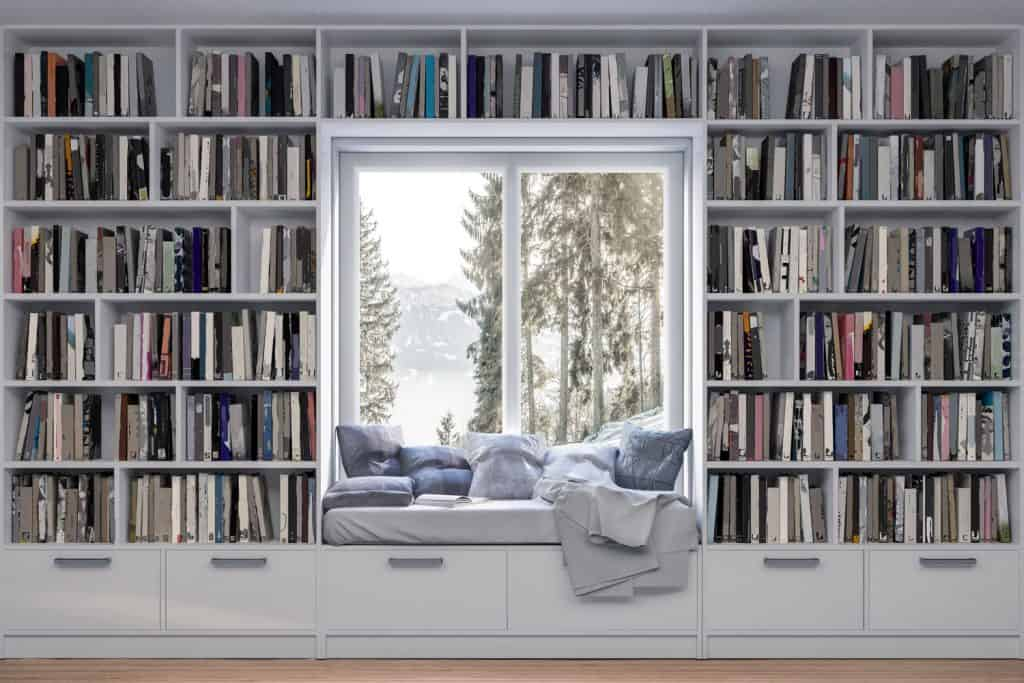 A huge bookshelf with loads of different books and a reading area at the center