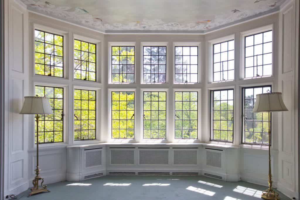 A large bay window of an empty dining area