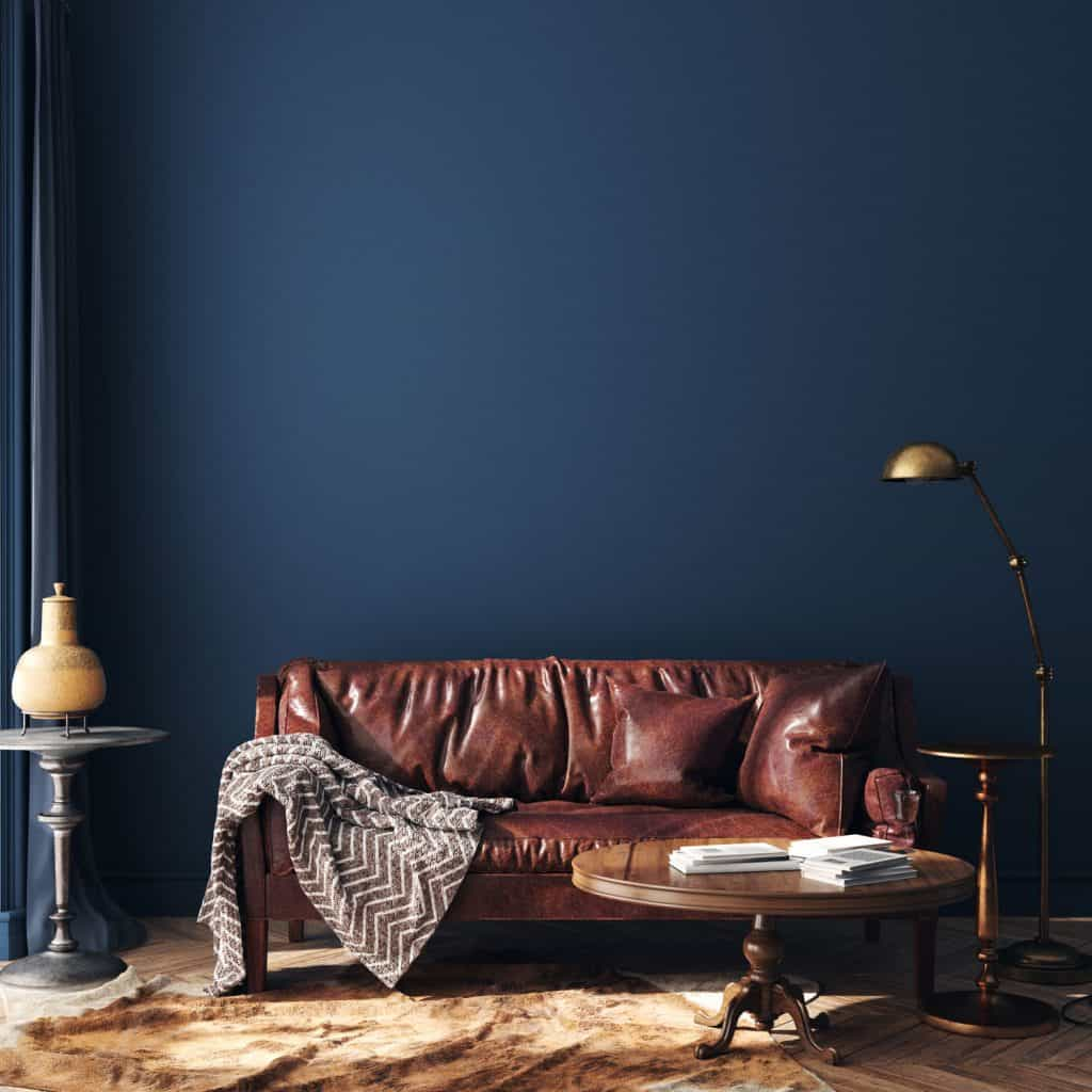 A leather couch inside a blue colored living room