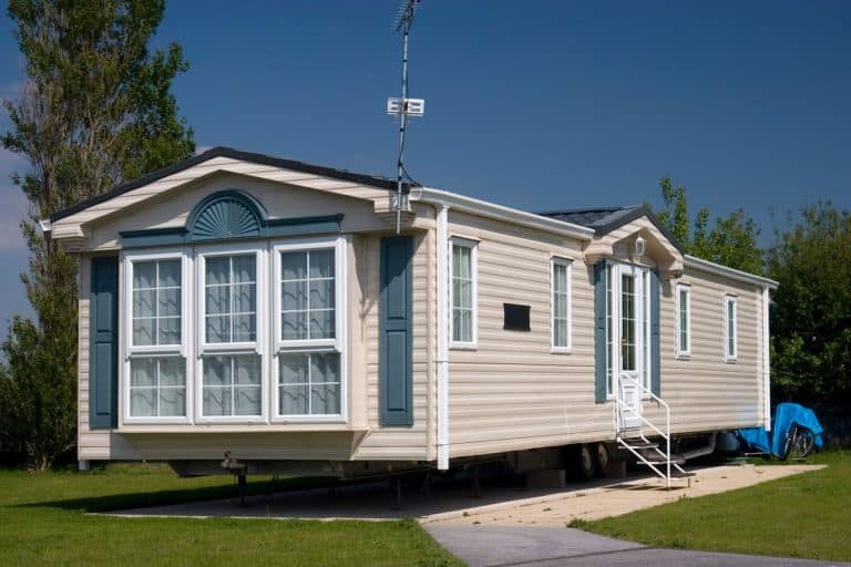 A luxurious mobile home with cream painted wooden vinyl sidings and a huge window up front, Can You Paint Vinyl Siding On A Mobile Home?