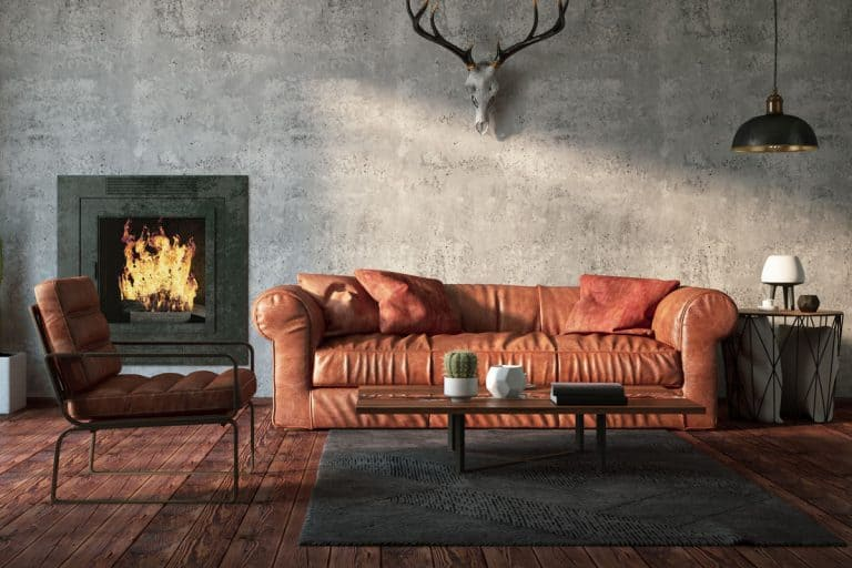 A Natuzzi leather sofa inside a ranch inspired living room with hard wooden flooring, How To Care For Natuzzi Leather Furniture