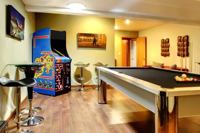 A play party room home interior with pool table, How To Arrange The Furniture In A Den?