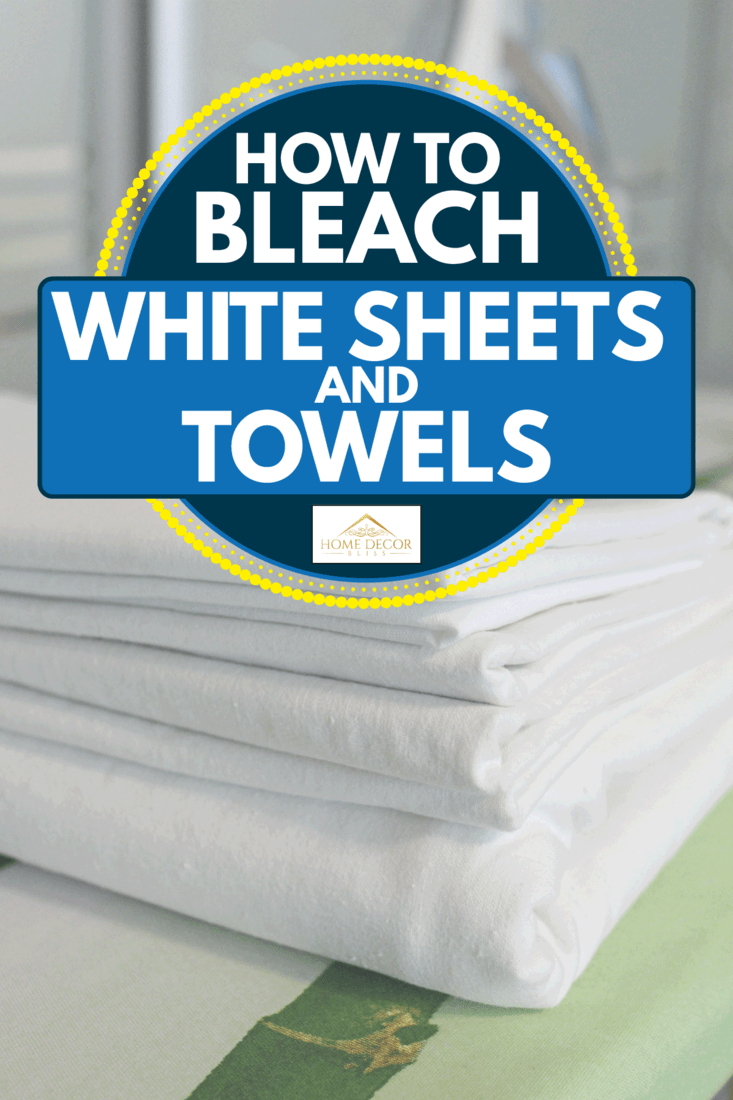 A stack of freshly washed white linen on an ironing board, an iron in the background, How To Bleach White Sheets And Towels