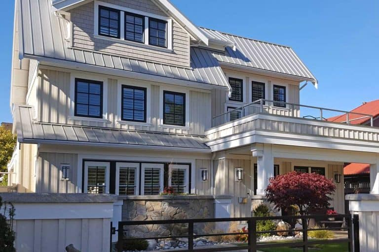 An exterior view of white and gray board and batten three story home, How Wide Are Battens On Board-And-Batten Siding?