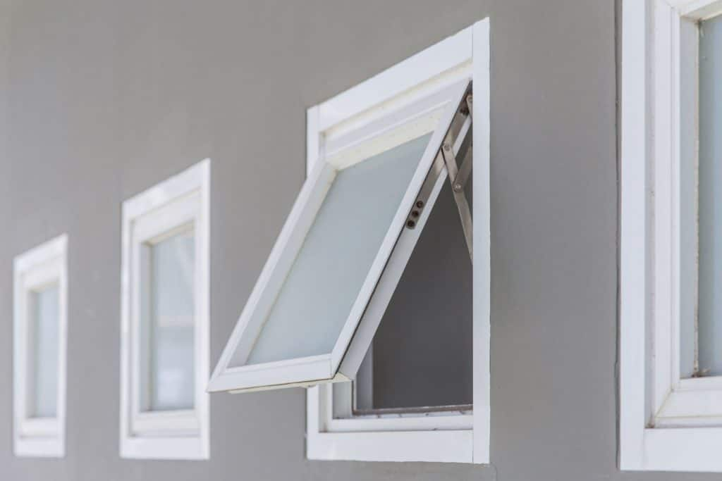 An opened white framed awning window