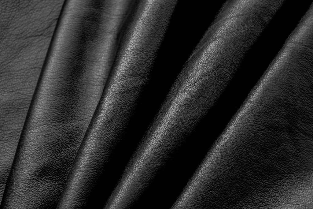 An up close photo of a wrinkled leather sofa