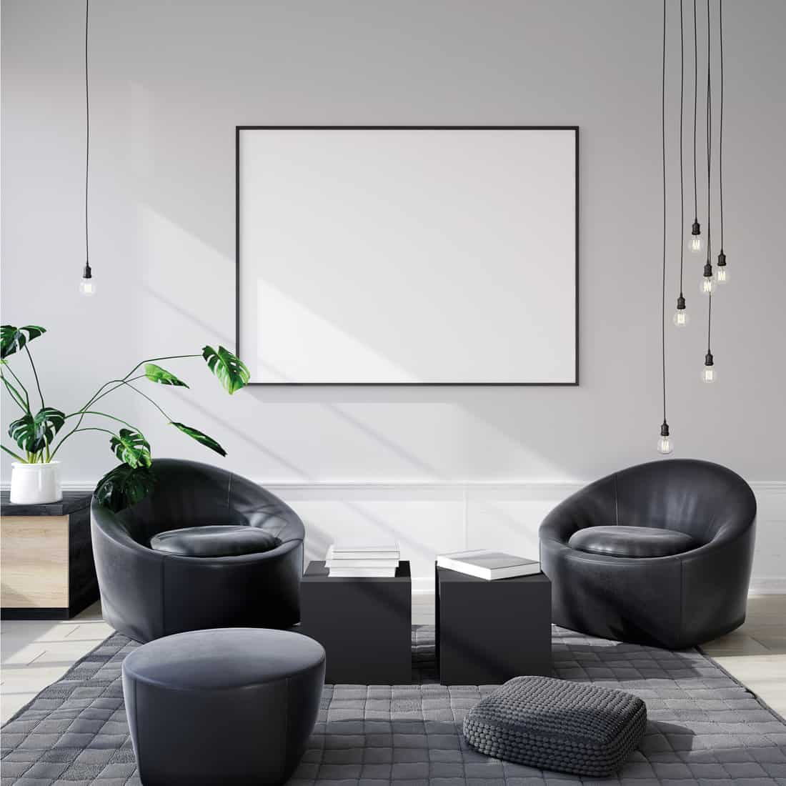 Armchairs, Storage Cubes, and Cushion Seats and hanging pendant bulb lights in a modern living room in black and grey theme