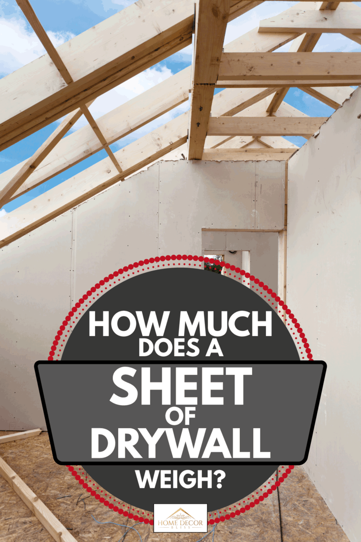 Attic room under construction with drywall boards, wooden roof frame, How Much Does A Sheet Of Drywall Weigh?