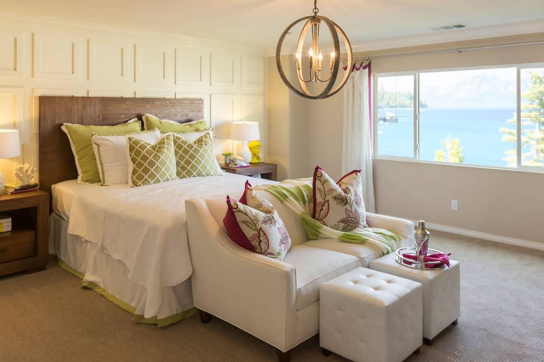 Beautiful Inviting Bedroom Interior with loveseat sofa