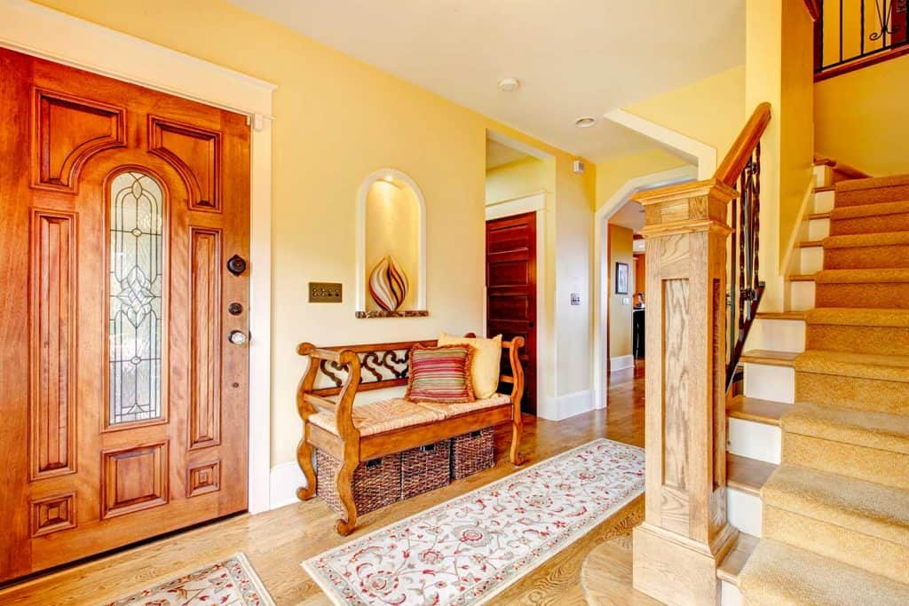 Beautiful hallway with rustic and wicker storage seat