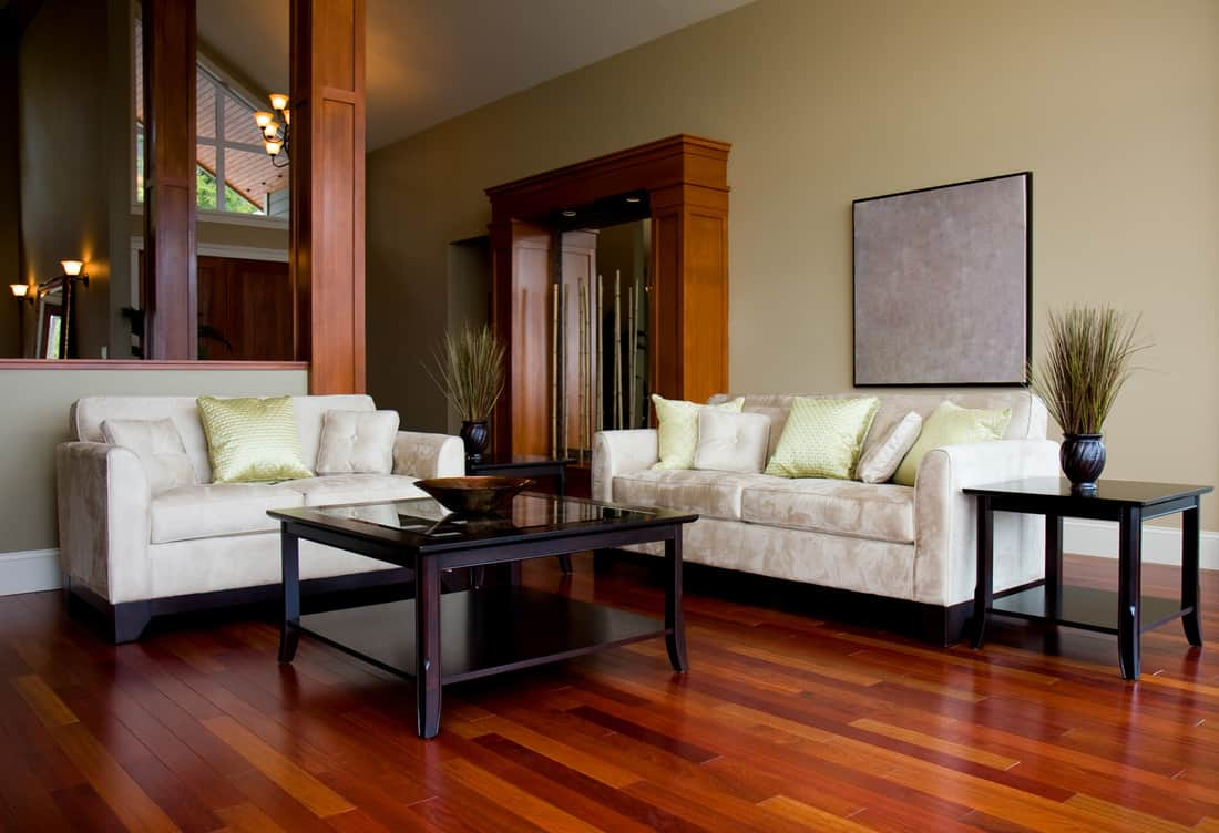 Beautiful hardwood floors highlight the living room of a new luxury home where the coffee table matches the end table