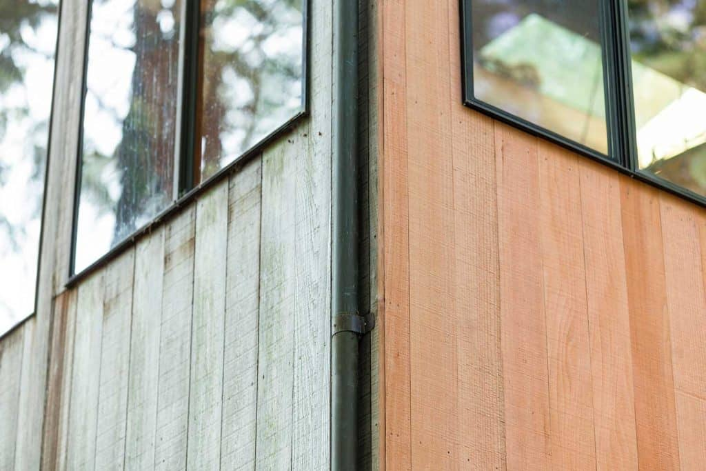 Before and after of redwood siding on home