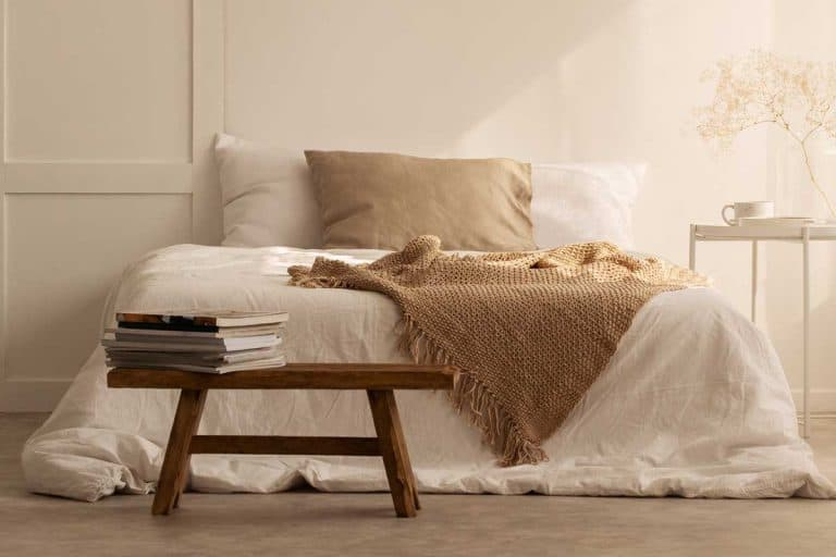 Beige blanket on the double bed in stylish wabi sabi bedroom of minimal style house, How Long Do Flannel Sheets Last?