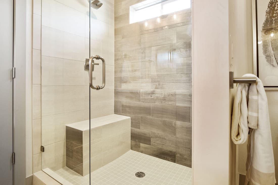 Bench inside shower for ability to shave and sit